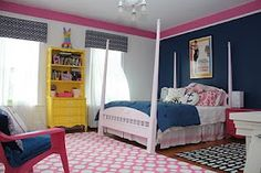 Sj bedroom. Navy, pink and yellow.