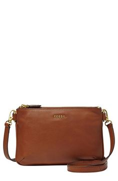 Fossil's softest pebbled leather gives a lush feel to the streamlined Memoir crossbody, outfitted with plenty of pockets that make staying organized a style all its own. Color(s): black, brown, medium blue, pastel green. Brand: Fossil. Style Name: Fossil 'Memoir' Crossbody Bag. Style Number: 954413.