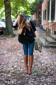black sweater and brown boots