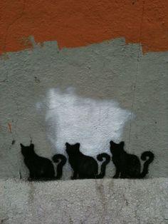 3 cat stencil street art in Midtown, NYC