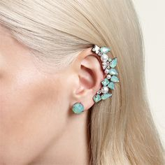 If you're brave I would go an ear cuff. Super sexy and it lightens the tone set by your shoes.