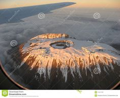 Photo about Flyover of Mount Kilimanjaro showing effects of Global Warming. Image of volcano, warming, kilimanjaro - 11217707 Effects Of Global Warming, Mount Kilimanjaro, Volcanoes, Earth, Movie Posters, Photography, Image, Photograph, Film Poster