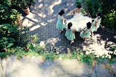 shot from above of the bridesmaids getting the bride ready for her first look with the groom | mint + pink vintage storybook wedding | click thru for more pin-worthy images!  http://su.pr/2vLBtp