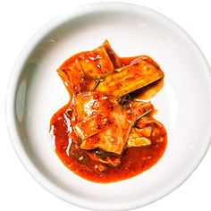 Kimchi (fermented pickled vegetables). The staple dish of Korean food originated to preserve veggies for winter. Traditionally brined radish or cabbage, South Korean kimchi tends to be sweeter, saltier, and spicier than North Korean, which is milder, more acidic, and strong on garlic and ginger. Eat it as a snack or with bibimbap.