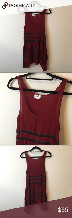 Free People Intimately Burgundy Voile Trapeze Slip Cute and lacy - free People Burgundy Slip with Lace and an asymmetrical bottom. Not lined and was worn once great condition! Free People Dresses