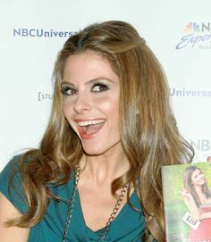 Maria Menounos rocks a center part, loose curls hairstyle
