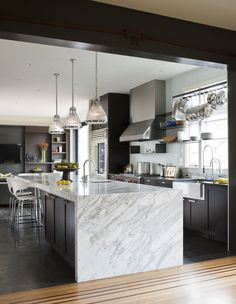nb design group capitol hill kitchen this wrap around marble countertop is