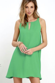 Worn dressed up or down, the BB Dakota Rachel Green Shift Dress always looks good! A high neckline with a notched, V-cutout and twin, spaghetti straps, supports a lovely shift bodice composed of lightly textured woven fabric.