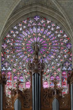 Impressive stained glass  rose window, south   transept,  Tours Cathedral, France