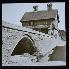 original Lantern slide dating to the last quarter of the 19th century c1890/1900. This attractive image is labelled 'Dunster Old House.' Some of my ancestors were from Dunster and I am doing a One-Place Study of the village - if you're researching the surname Thomas or interested in the genealogy of the villagers, do get in touch! esjones <at> btopenworld.com