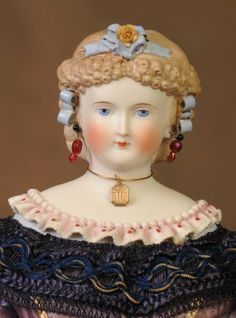 German parian shoulder head doll.
