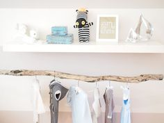 Use a long piece of driftwood as your closet hanging bar. No need to cover this closet up with doors or curtains!