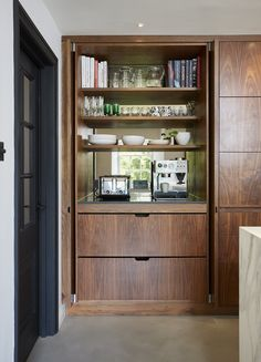 Pocket door kitchen pantry / storage. Made extra special with internal drawers, stone worktop and mirrored splashback.