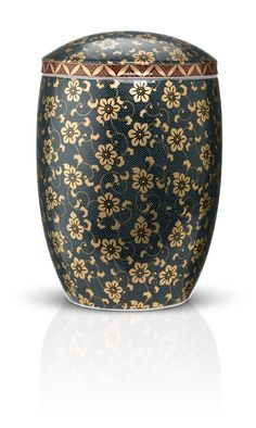 Imperial Blue - By Urns In Style.  Dignified and delicate, regal and restrained, this decorative urn features pure gold in an intricate floral pattern against a beaded surface of royal blue. Impeccable craftsmanship in a hand wrought treasure from Japan. Exclusive to Urns In Style.