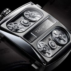 Tag Heuer Monaco V4 - This is actually a belt driven watch (not gears) which already makes it cool, but I love the look and feel of the entire watch just as well (this is a pic of the back of the watch)