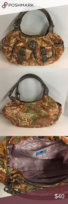 👜Kathy Van Zeeland Bag 👜Kathy Van Zeeland Bag. In excellent condition!!! Super cute with pretty pink interior and several pockets. Side pockets and front pockets(snap shut). Faux croc handles and snap shut. Kathy Van Zeeland Bags Satchels