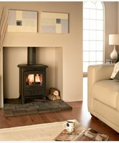 Google Image Result for http://shop.bestchoicefireplaces.co.uk/media/catalog/product/cache/1/image/5e06319eda06f020e43594a9c230972d/v/a/valor-arden-multifuel-stove.jpg