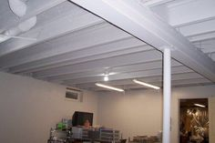 to Paint a Basement Ceiling with Exposed Joists for an Industrial Look Great tutorial on how to paint a basement ceiling.Great tutorial on how to paint a basement ceiling. Old Basement, Basement Makeover, Basement Bedrooms, Basement Walls, Basement Renovations, Home Remodeling, Basement Ideas, Basement Bathroom, Walkout Basement