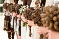 Fall Wedding ideas: Pinecones, pumpkins, wood, berries, wheat, acorns, and feathers