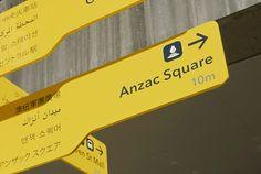 foreign language wayfinding signs by dotdash in brisbane, australia - designboom | architecture & design magazine