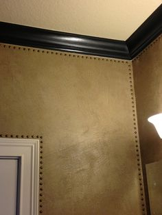 Modern Masters Metallic Plaster and glaze with decorative nail heads on walls by Karla Boddie