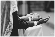 Bride and Groom praying during their Catholic Wedding Ceremony in Calgary. For more church wedding, check out our blog: www.sujataphotography.com/blog