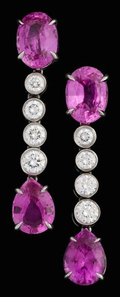 Lady's platinum and diamond pink sapphire drop earrings, Bvlgari Oval cut pink sapphire followed by four graduated collet set round brilliant cut diamonds finishing in a single pear shaped pink sapphire drop, signed by the maker, French omega post backing, accompanied by original box. Sapphire Pendant, Sapphire Jewelry, Sapphire Earrings, Rose Earrings, Pink Sapphire, Bulgari Jewelry, Pink Jewelry, Bvlgari, Chandelier Earrings