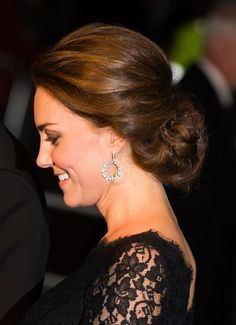 Pin for Later: It's a Girl! Celebrate the New Princess With Kate Middleton's Most Stylish Maternity Moments Kate Middleton Style Kate finished her look for the Royal Variety Show with a pair of stunning diamond-embellished drop earrings.