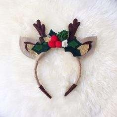 Gorgeous red holly and evergreen deer flower crown. Perfect for the holidays! All hand cut with felt wrapped headband for comfort. Made from high quality wool blend felt. Choose with or without antlers. Ears and antlers are double layered with batting (Ears) or wire (antlers) in the