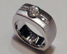14k white gold band with Diamonds