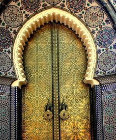 Star-patterned golden arched doorway and ornamental tilework, Fez, Morocco