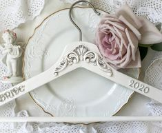 This set of 2 Mr and Mrs hanger - vintage Custom Groom and Bride hanger or hanger made in Rustic style is just gorgeous. Victorian Wedding dress hanger is Custom Personalized for Groom and Bridal. Custom made to order On a peg I will write your name and date of your wedding. Write to me about it and I will execute your desire. Hanger also makes a stunning photo prop for the wedding dress and a unique and thoughtful bridal shower gift or couple gift! Bride Hanger, Wedding Dress Hanger, Wedding Hangers, Wedding Dresses, Thoughtful Bridal Shower Gifts, Vintage Christmas Balls, Bridesmaid Hangers, Iron Orchid Designs, Bride Gifts