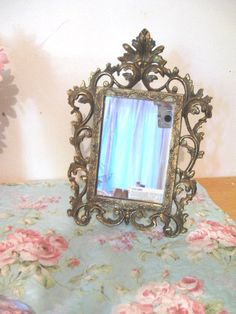 Hello!  I am delighted to offer this gorgeous, antique mirror from the early 1900s, found at a Maryland estate sale.  Heavy solid brass and