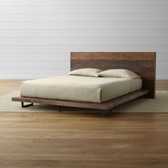 Shop Atwood Reclaimed Wood Queen Bed.   Angular iron legs add a geometric accent.  The Atwood Queen Bed without Bookcase Footboard is a Crate and Barrel exclusive. We've got great .