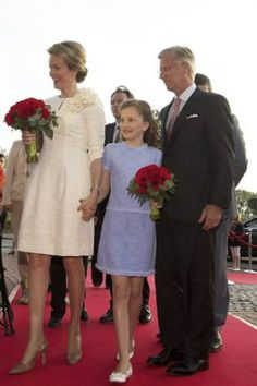 (L-R) Queen Mathilde of Belgium, Crown Princess Elisabeth and King Philippe of Belgium during a representation of musical '14-18' at the Nekkerhal in Mechelen, in presence of Royal couple, 25.04.14