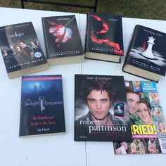 Twilight bundle ! Twilight bundle !   Complete Twilight series ! Twilight and New Moon are paperback Eclipse and Breaking Dawn are hardback  Includes the Twilight Companion book, a Robert Pattinson book with poster still included and an OK! Magazine announcing their wedding .  Includes all 4 movies, too !  The only problem is that the books have a slight yellowish color to the pages. Other