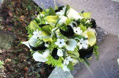 green white and black for the bridesmaids. but i hope to find white flowers that are naturally less white more cream.