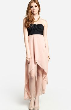 Strapless high low maxi dress featuring a black pleated bodice, slight padding in bra cups, elastic criss cross back, asymmetrical wrap skirt, full lining, and invisible side zipper with hook and eye closure.