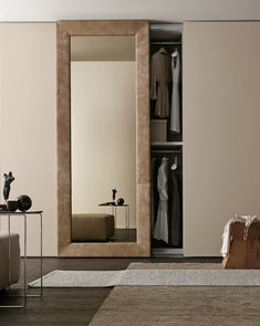 Sectional mirrored wardrobe with sliding doors MIRROR by Presotto Industrie…