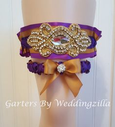 Royal purple and gold #wedding #garter set done in LSU team colors.   The keepsake garter is royal purple centered with gold and  banded with a darker purple  and accented wi... #bride #bridal #weddings #ido #bridalgarter #weddinggarterbelt ➡️ http://jto.li/CJfCw