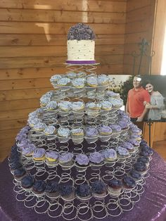 Topper cake piled high with ruffled purple flowers with ombre shades of purple jumbo cupcakes in a springing cupcake tower! Purple Hues, Shades Of Purple, Purple Flowers, Purple Cupcakes, Create A Cake, Wedding Cake Toppers, Party Cakes, Bride, How To Make