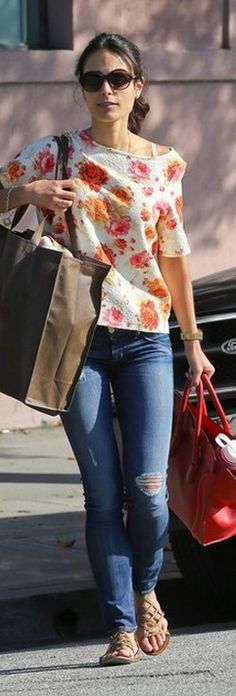 Who made Jordana Brewster's rose floral top, red tote handbag, and nude flat sandals? Shirt – Zara  Shoes – Tory Burch  Purse – Celine