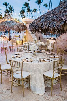 gold colored beach themed wedding reception ideas with hanging lights