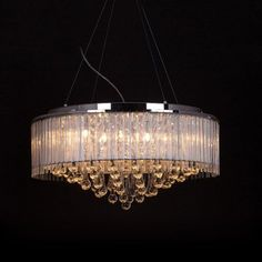 Tomia L 1620/08/007 CH Tessa Chandelier This product from Tomia is for use with eight 40-watt halogen bulbs.  Tessa Chandelier24% lead crystalSilver fabric