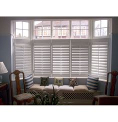 Cafe-style bay plantation shutter and built-in window seat. Really like the shutters here, would be great for ben and I. I wonder if we could find 2 way blinds or some similar window coverings?