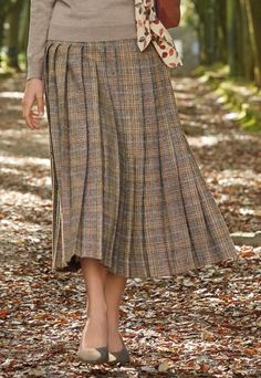 With tweed woven in a British heritage mill, this superb skirt is made in classic dogtooth check. This fully lined style has knife pleats sewn down to the hip, a side zip fastening and side back waistband elastication. Knife Pleated Skirt, Midi Skirt, Fashion Clothes, Fashion Outfits, Classy Work Outfits, January 10, Traditional Outfits, Autumn Leaves, Tweed