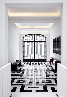 Geometric metal doors. Floors.