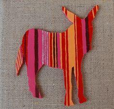 créé à partir d'une chantourneuse en bois,puis accroché sur un tableau toile de lin, création Sandrine M