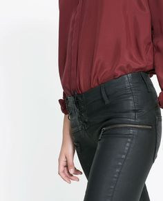 Image 5 of SKINNY TROUSERS WITH COATED SEAMS from Zara
