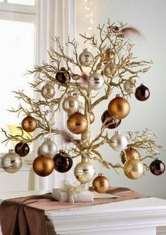 Cristhmas Tree Decorations Ideas : Tabletop Christmas Tree…love the branches and copper/silver/chocolate ornaments Tabletop Christmas Tree, Noel Christmas, Christmas Countdown, Xmas Tree, All Things Christmas, Christmas Crafts, Christmas Ornaments, Modern Christmas, Christmas Tree Ideas For Small Spaces